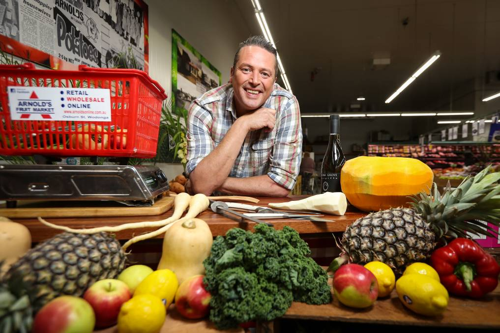 FRESH APPROACH: Celebrity chef James Reeson selects produce from Arnold's Fruit Market to film Alive and Cooking in Wodonga on Thursday. Pictures: JAMES WILTSHIRE