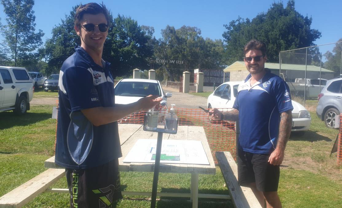 SAFETY FIRST: Kiewa Cricket Club members make the most of the COVID-19 hand sanitisation station after receiving a grant to help them with COVID safety.