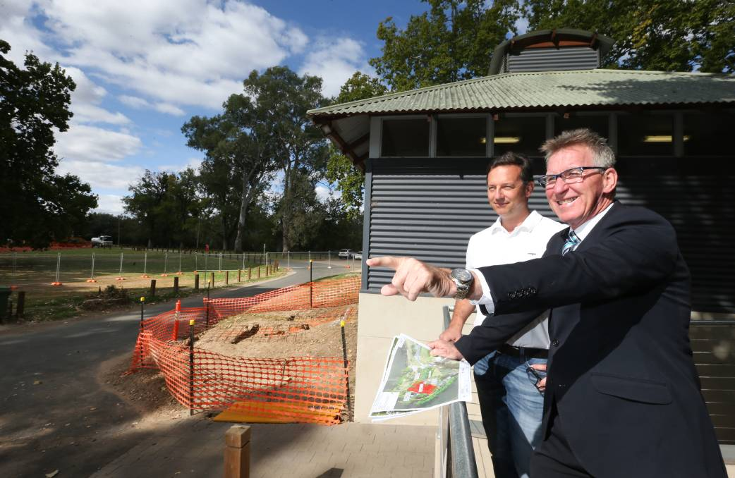 Flashback: River Deck cafe owner Alex Smit and Albury mayor Kevin Mack in 2019 when plans to upgrade Noreuil Park were outlined. A letter writer has congratulated the council on its work at the site, stating it is good value for money.