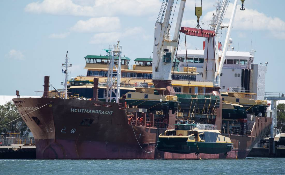 Coming soon: The Indonesian-made ferries, including the as yet unmarked Lauren Jackson, are unloaded in Newcastle earlier this month. Picture: NEWCASTLE HERALD