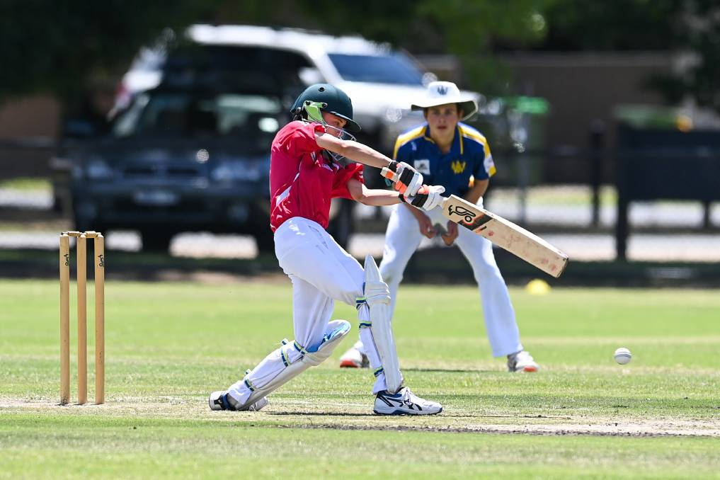 TIMING'S RIGHT: CAW Country opener Josh Power looks to pierce the field against Wangaratta Gold in their under 15 match. Picture: MARK JESSER