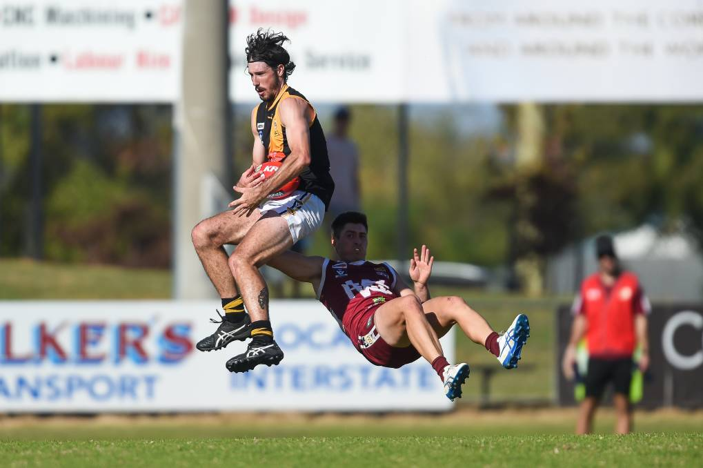 TIGER TRAP: Albury's Jessy Wilson marks and Wodonga's Khyle Goodman is on the receiving end. Picture: MARK JESSER