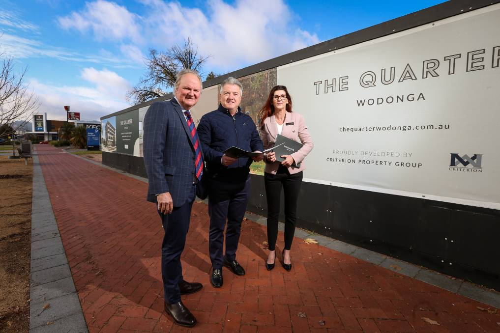 READY TO ROLL: The Quarter developer John Mooney, centre, with agents Andrew Dixon and Heidi Bourke. Picture: JAMES WILTSHIRE