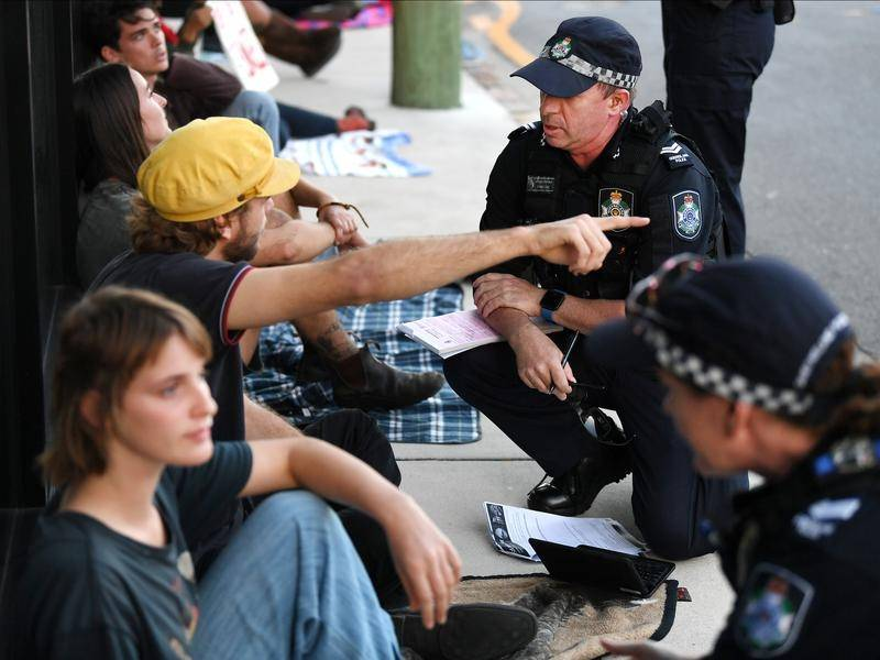 Police are negotiating with protesters at a Brisbane hotel where asylum seekers are detained.