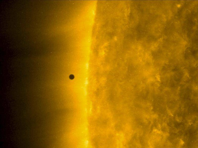 NASA's Solar Dynamics Observatory image shows Mercury as it passes between earth and the sun.