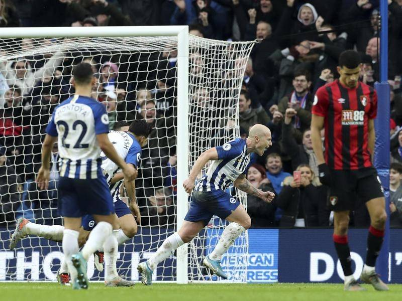 Aaron Mooy (C) has scored twice this season for Brighton which has helped earn him a permanent deal.