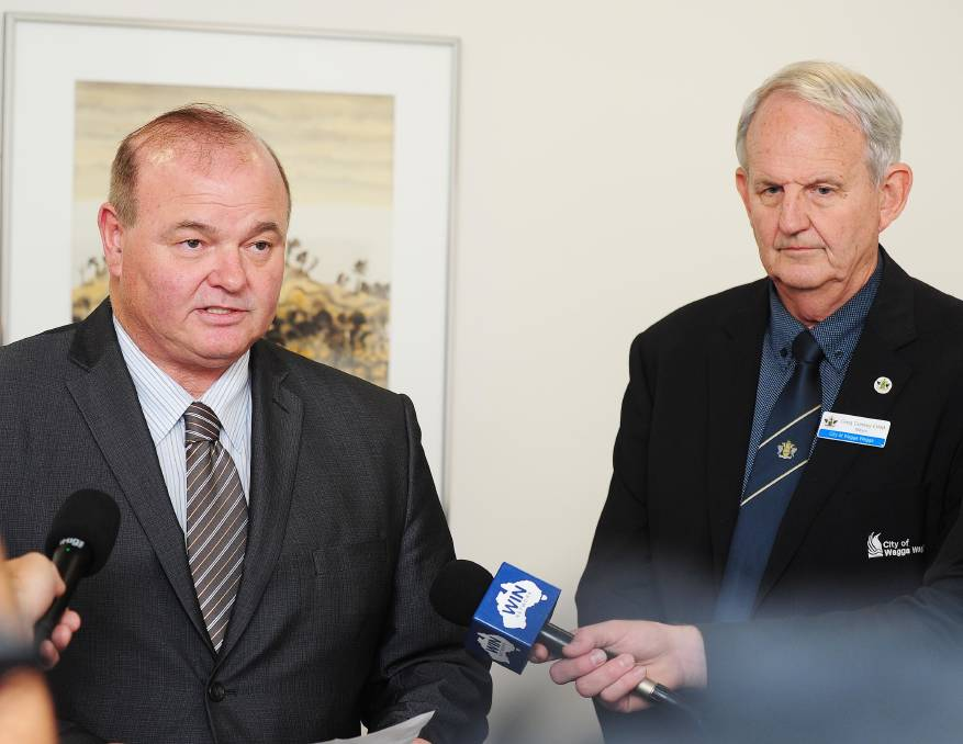 SHOWDOWN: Former Wagga City Council general manager Alan Eldridge (left) addresses the media alongside mayor Greg Conkey in November 2016. Mr Eldridge has taken the council to the Supreme Court over unfair dismissal claims.