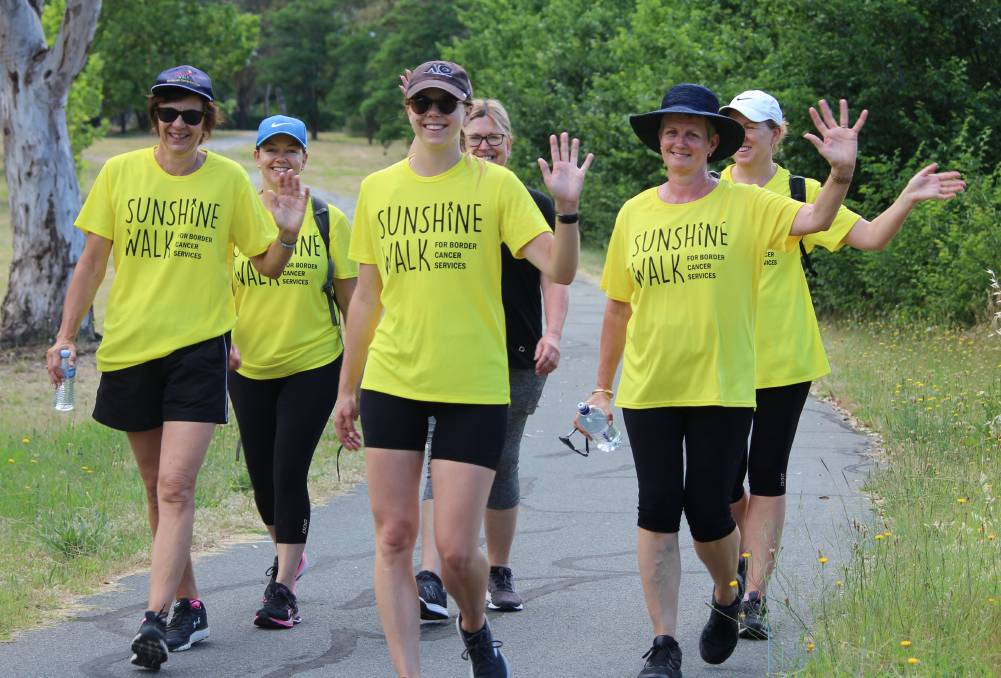 SAY HELLO: Albury Wodonga Regional Cancer Centre Trust Fund chairperson Michelle Hensel (left) walks with her Hume Public School team. Organisers were overwhelmed by the virtual Sunshine Walk's success. Picture: SUPPLIED